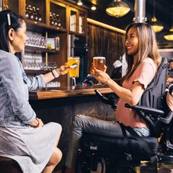 Accessibility Two women sat in a bar - Photo by ELEVATE from Pexels